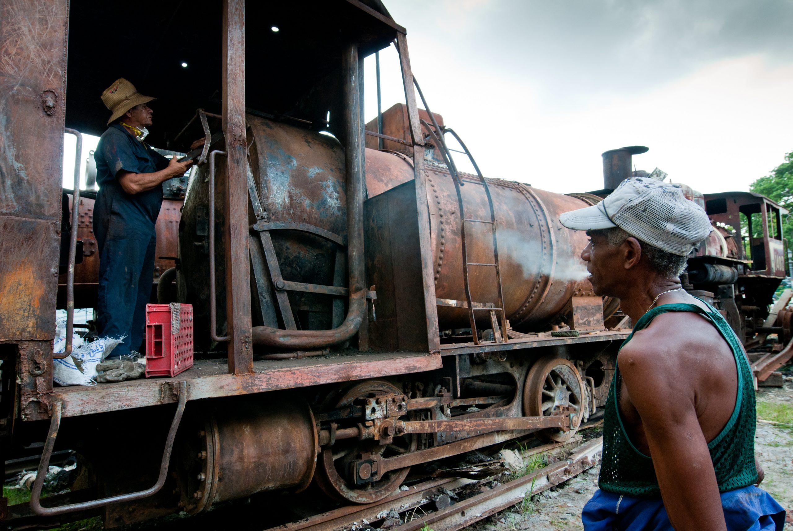 Self-employed Cubans repair on October 24, 2011, an old steam locomotive used from the end of the 19th century in sugar cane production.      (STR/AFP/Getty Images)