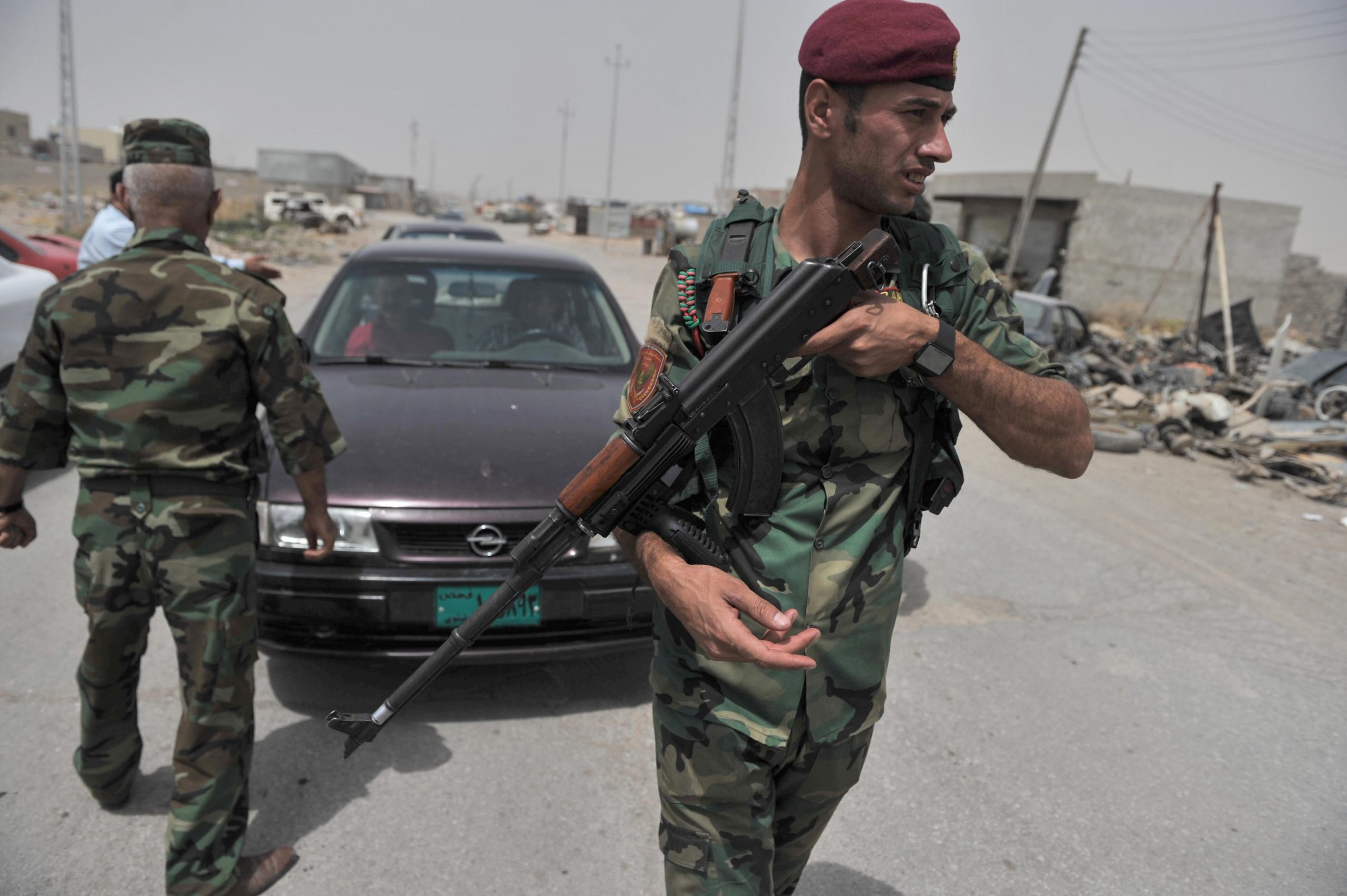 Peshmargas of Iraq Kurdistan Regional Government take security precautions on Mosul-Erbil road on the outskirts of Mosul after the militants of Islamic State in Iraq and the Levant seized Mosul, in Iraq on 12 June, 2014.