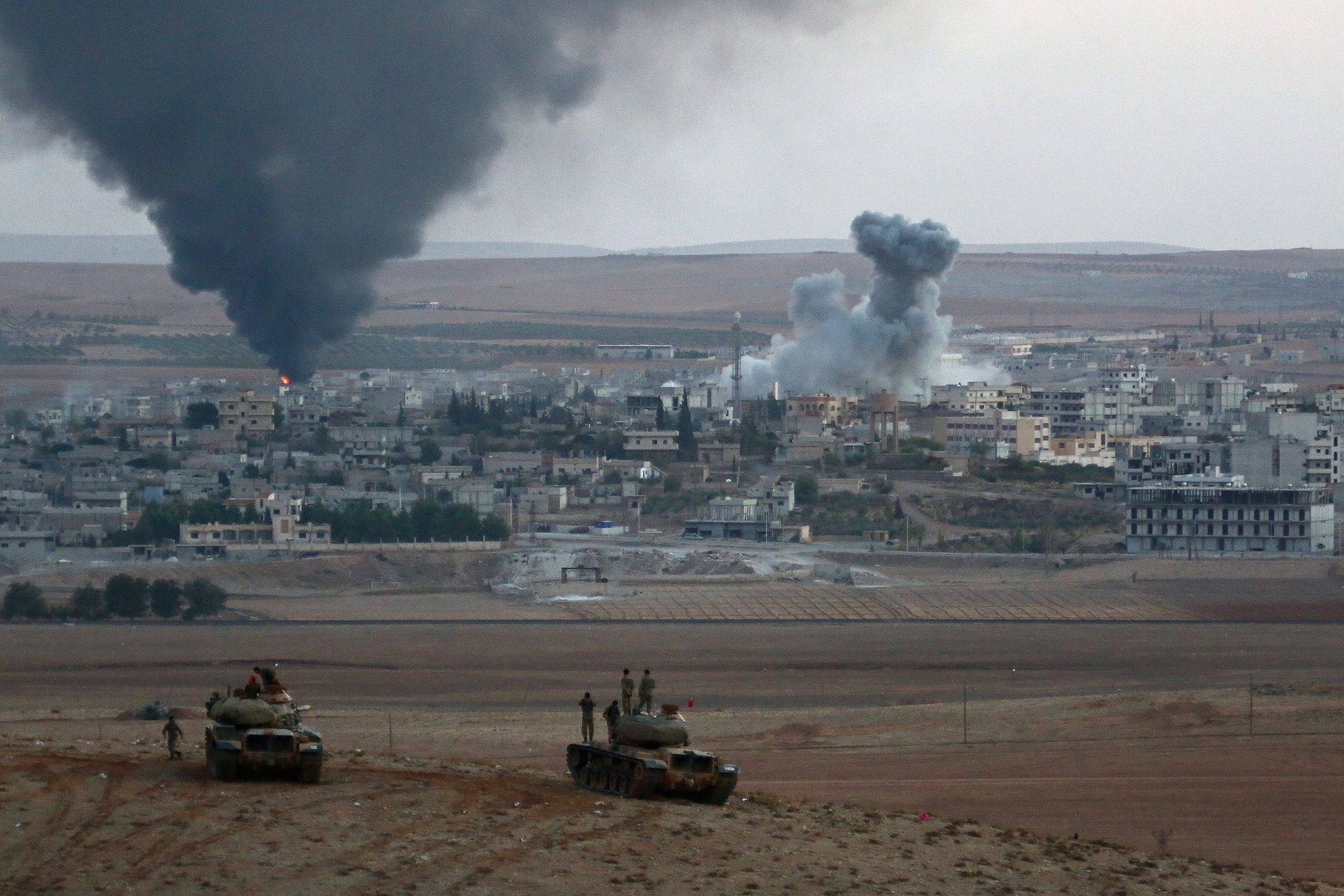 Smoke rises from the clashes in Syria's Ayn al-Arab city (Kobani).