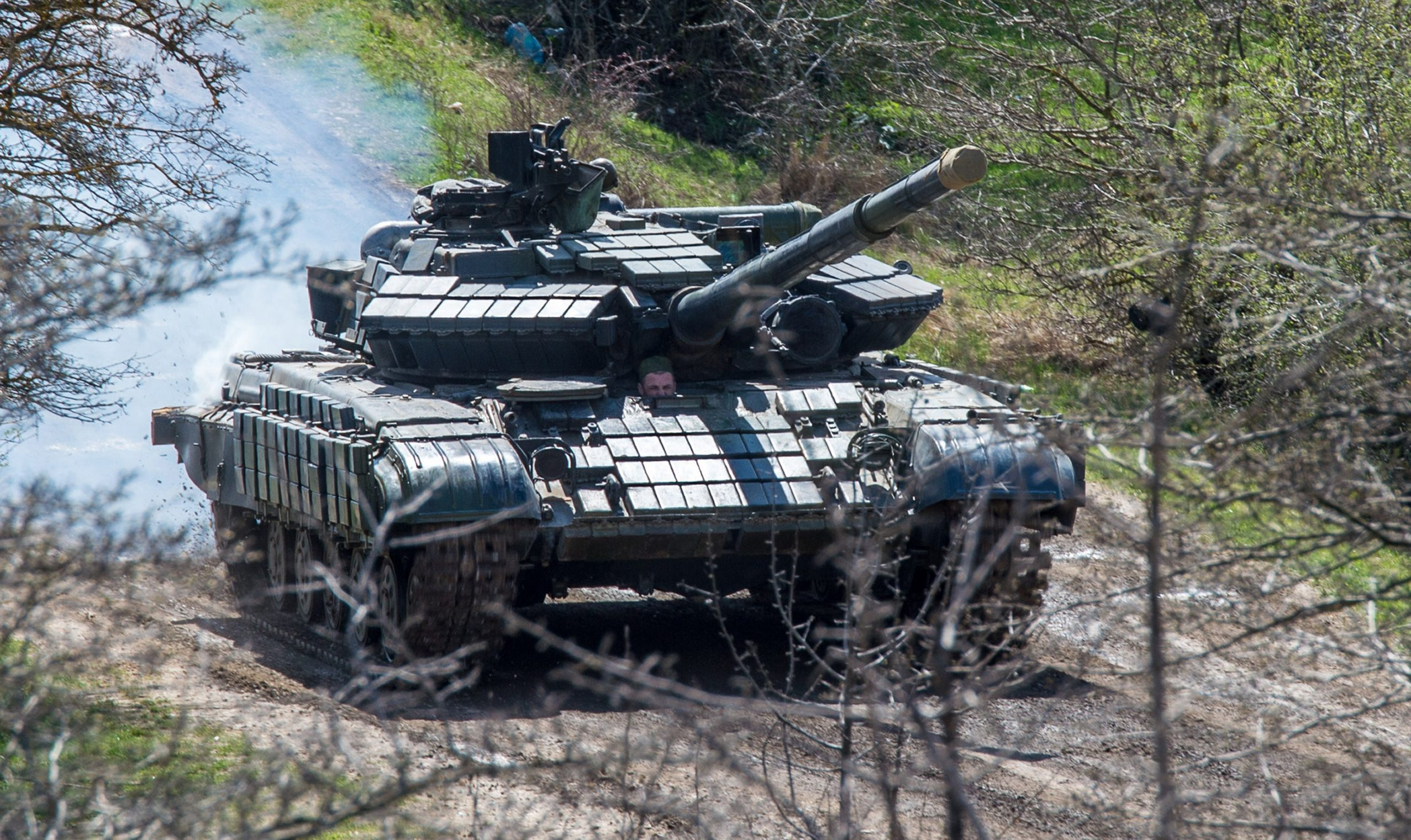 A Russian tank rolls outside a former Ukrainian military base in Perevalnoye, near the Crimean capital Simferopol.