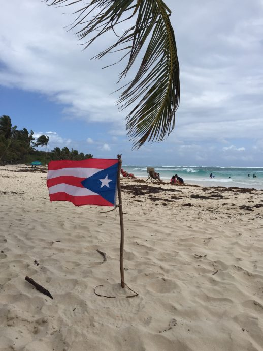 Puerto Rican flag on beach