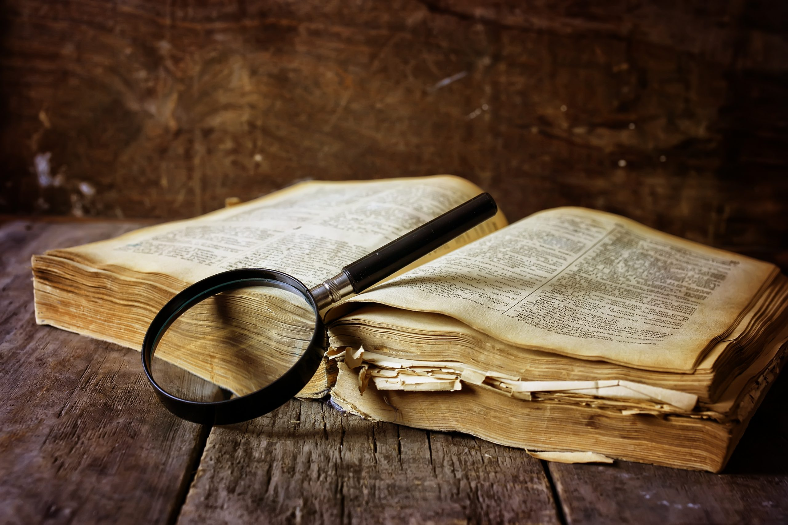 magnifying glass and old book