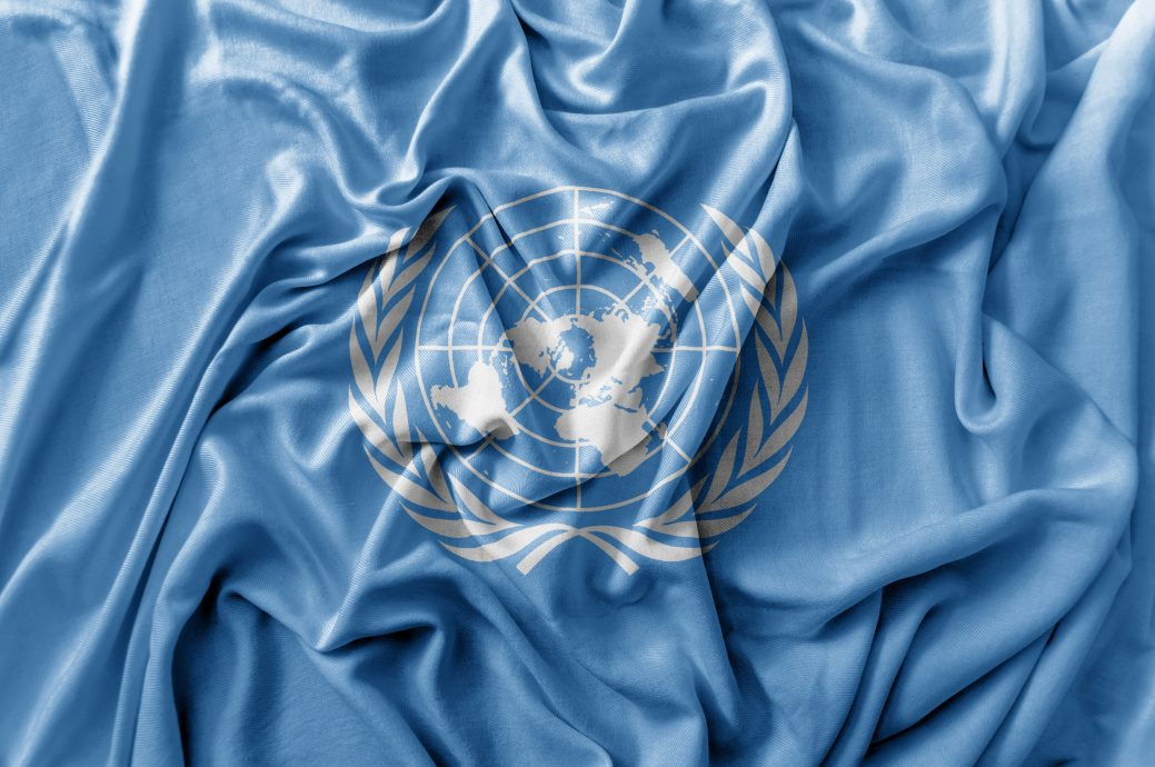 Ruffled waving United Nations flag