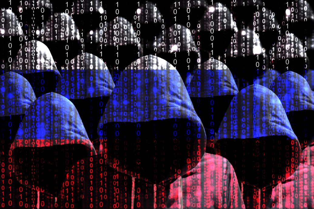 Group of hooded hackers shining through a digital russian flag