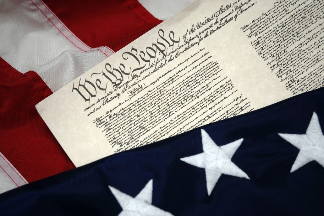 We The People – U.S. Constitution document and flag