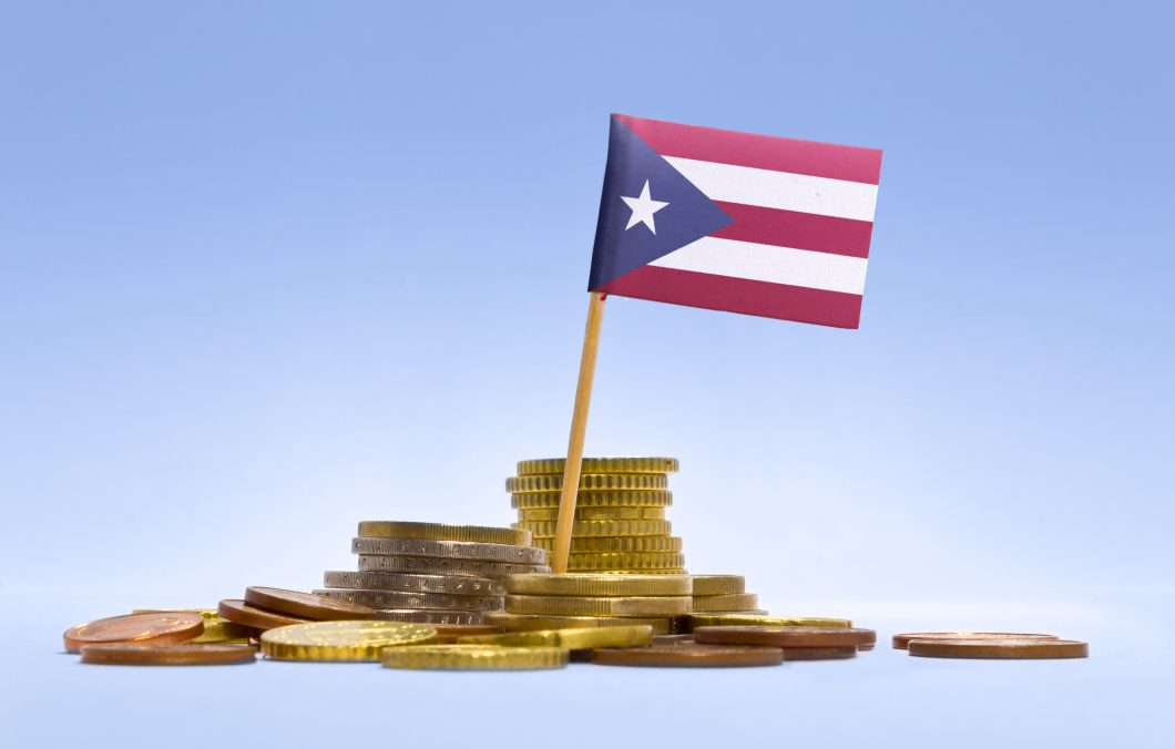 Flag of Puerto Rico in a stack of coins.(series)