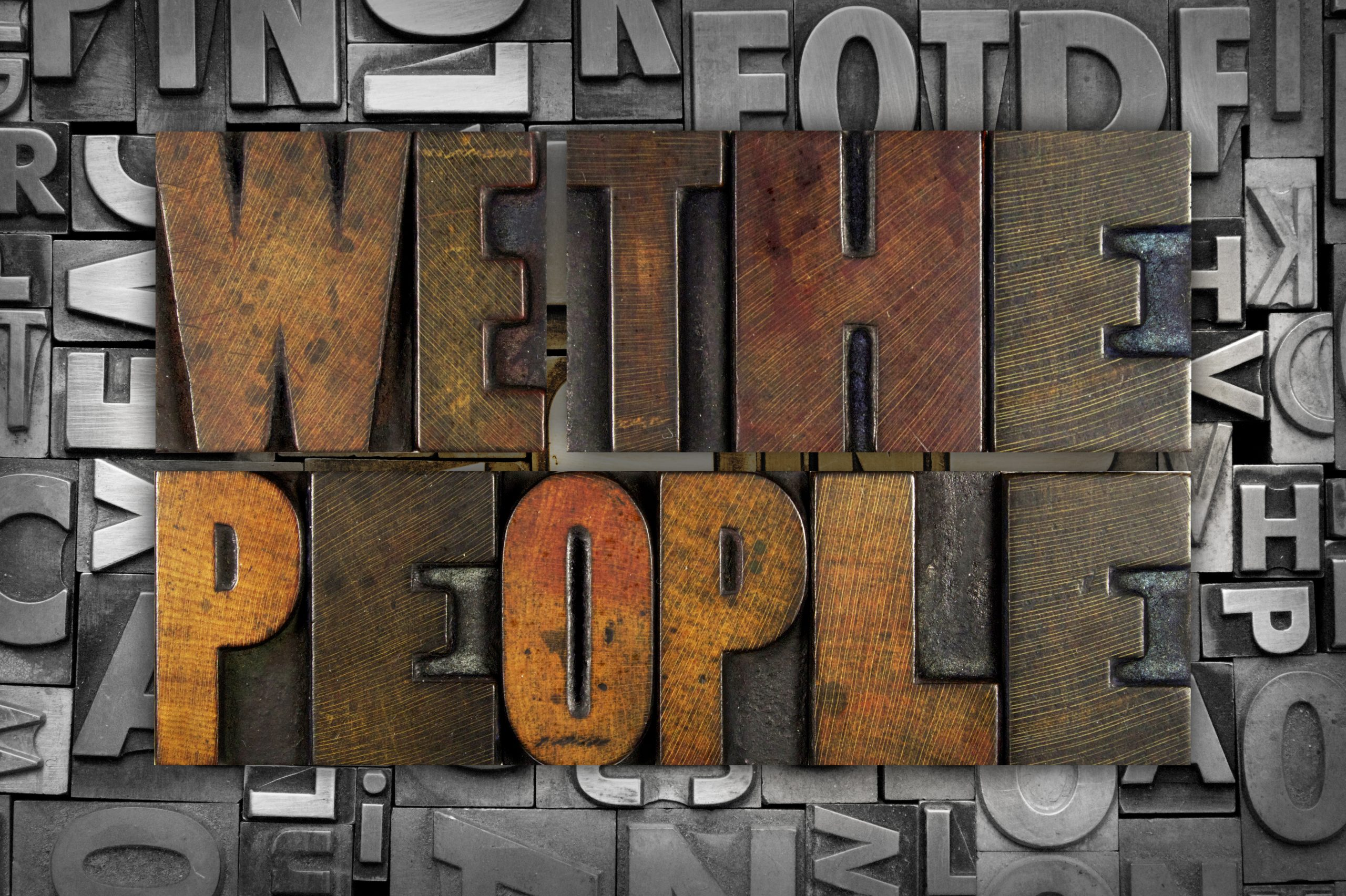 WE THE PEOPLE written in vintage letterpress type