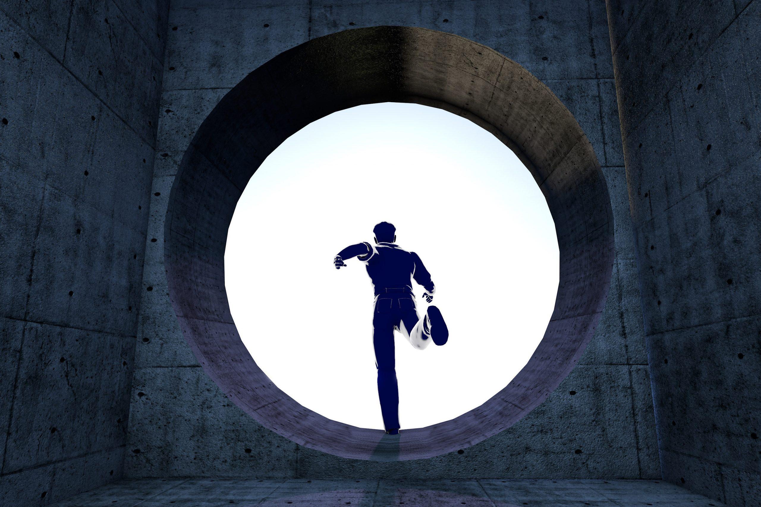 man running trough round window opening