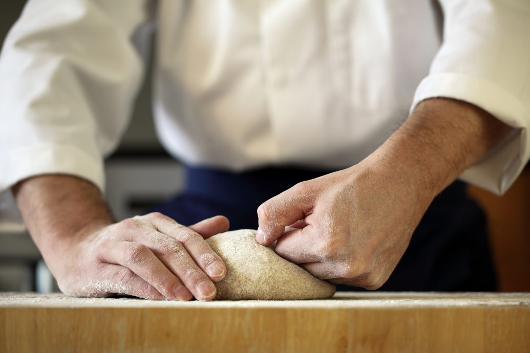 Chef kneading yeast dough