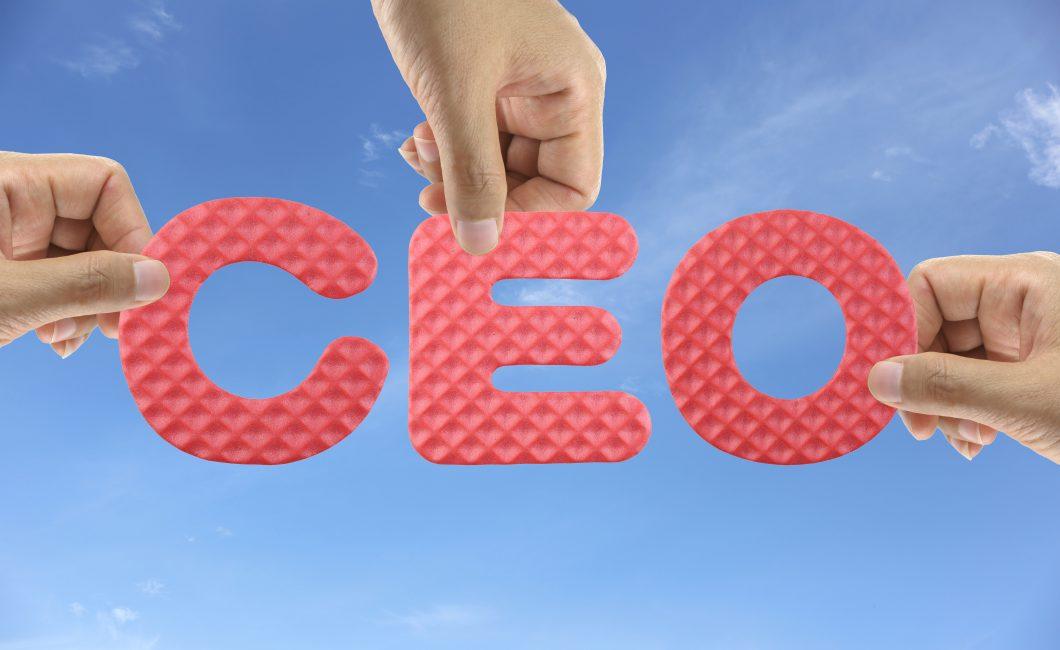 Hand arrange alphabet CEO of acronym Chief Executive Officer.