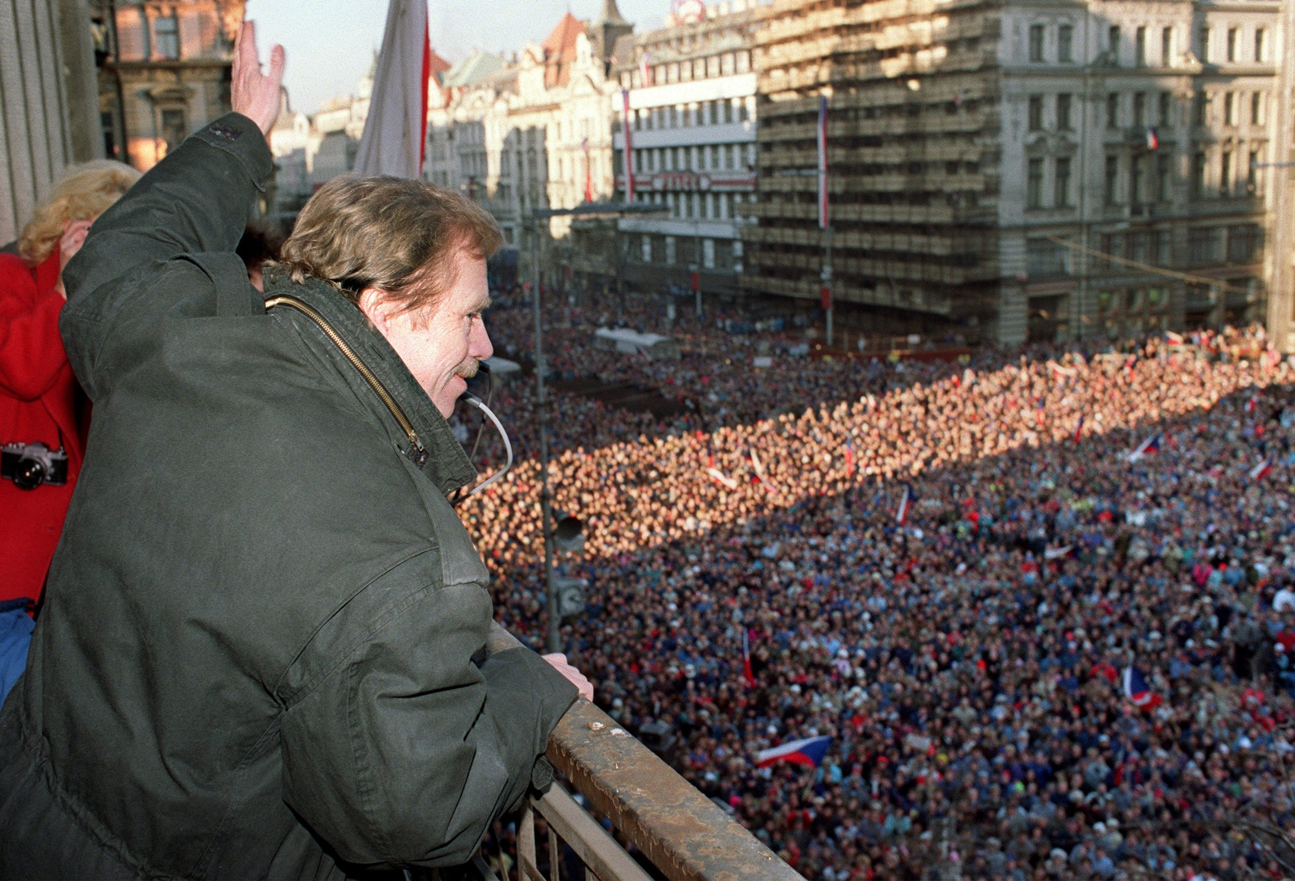 Vaclav Havel, a dissident playwright and leading member of the Czechoslovak opposition Civic Forum, who drafted large parts of Charter 77, the declaration which helped attract international attention to the civil rights abuses in Czechoslovakia, waves 10 December 1989 to the crowd of thousands of demonstrators gathered on Prague's Wenceslas Square, celebrating the communist capitulation and nomination of the new government formed by Marian Calfa from Slovak dissident movement the Public Against Violence. At the end of 1989, Havel was elected first president of the then Czechoslovakia when the state-communist system crumbled in the Velvet Revolution. AFP PHOTO LUBOMIR KOTEK        (Photo credit should read LUBOMIR KOTEK/AFP/Getty Images)