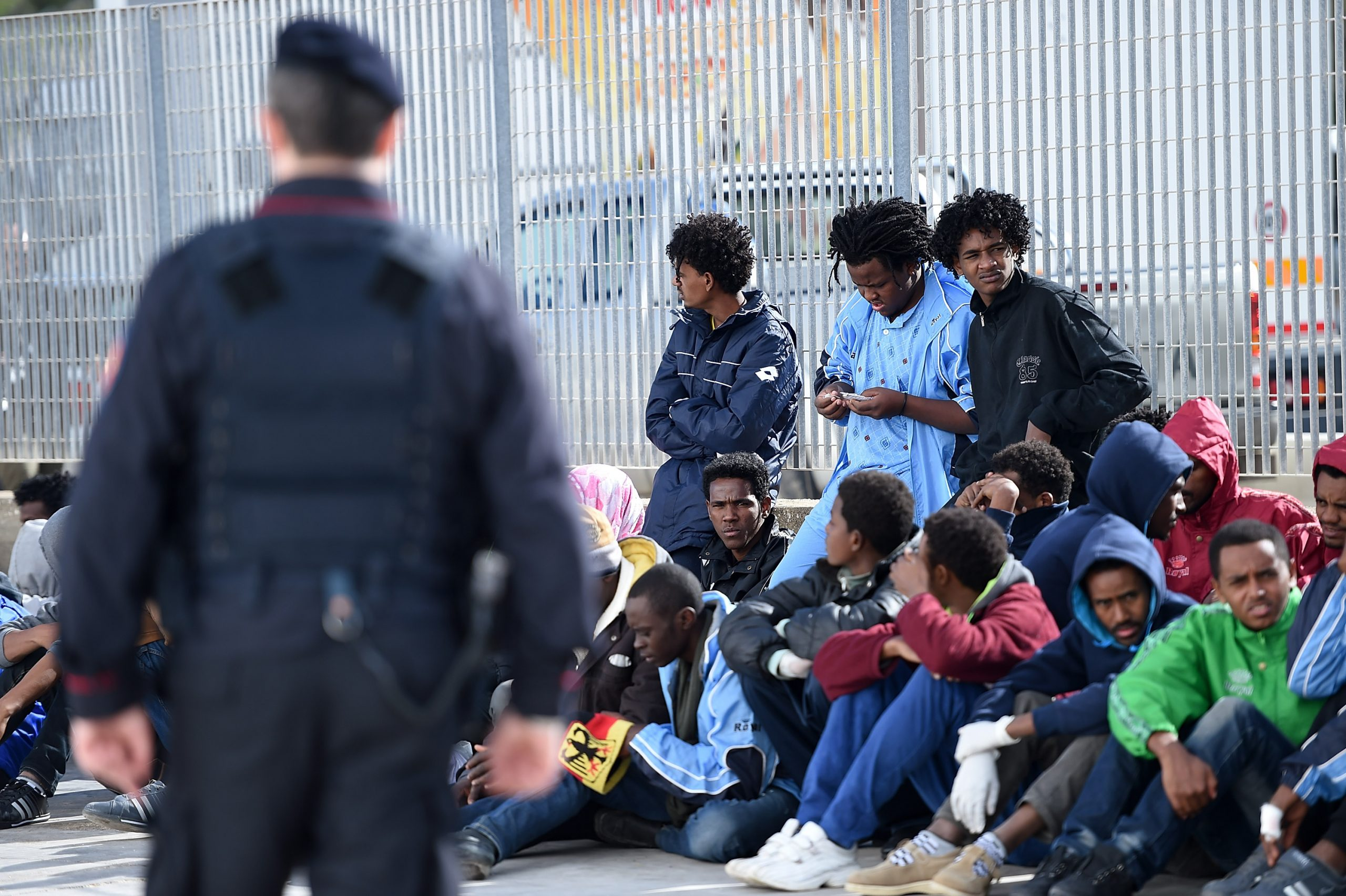 Immigrants wait to board a ship on February 18, 2015 in Lampedusa, Italy. Hundreds of migrants have recently arrived in Lampedusa. (Photo by Tullio M. Puglia/Getty Images)