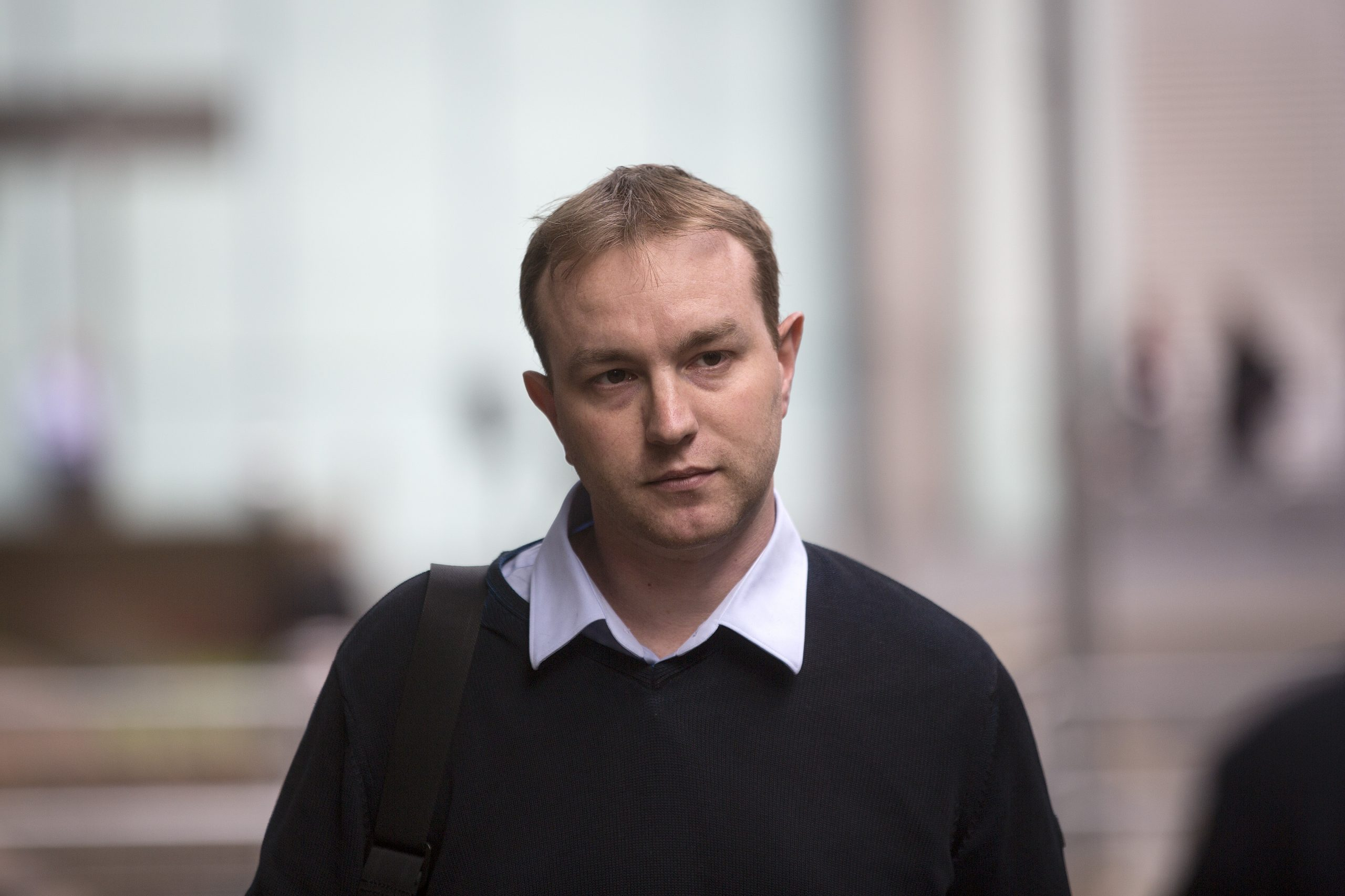 Thomas 'Tom' Hayes, 35, a former trader at banks including UBS Group AG and Citigroup Inc., leaves Southwark Crown Court following the first day of his trial in London, U.K., on Tuesday, May 26, 2015. Hayes was motivated by greed as he colluded with bankers, friends -- and even his half-brother -- to rig benchmark interest rates, prosecutors said at the first trial into the manipulation of Libor. Photographer: Simon Dawson/Bloomberg via Getty Images