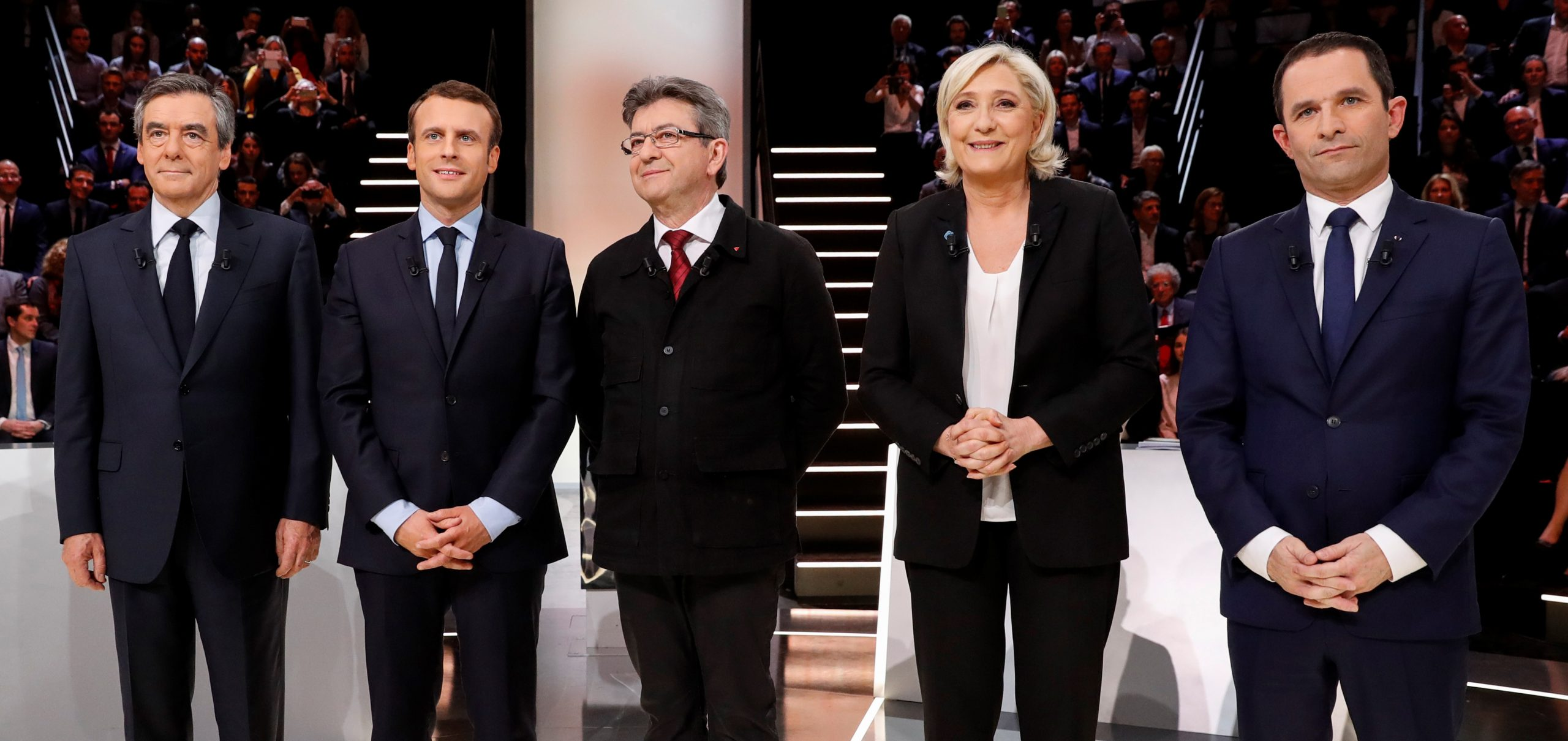 (LtoR) French presidential election candidates, right-wing Les Republicains (LR) party Francois Fillon, En Marche ! movement Emmanuel Macron, far-left coalition La France insoumise Jean-Luc Melenchon, far-right Front National (FN) party Marine Le Pen, and left-wing French Socialist (PS) party Benoit Hamon, pose before a debate on March 20, 2017. (PATRICK KOVARIK/AFP/Getty Images)