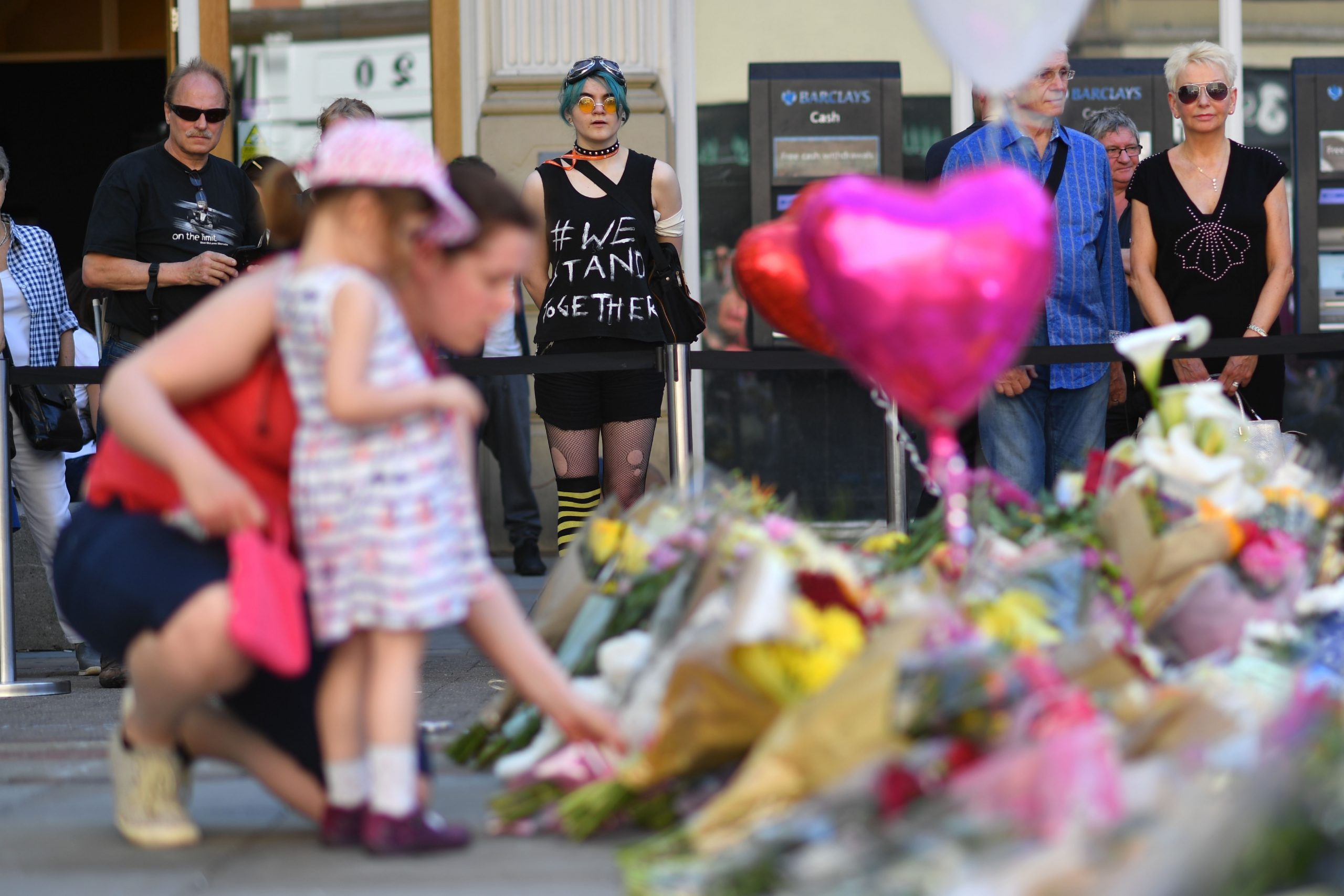 People lay flowers and messages in St Ann's Square in Manchester, England, placed in tribute to the victims of the May 22 terror attack at the Manchester Arena. (BEN STANSALL/AFP/Getty Images)