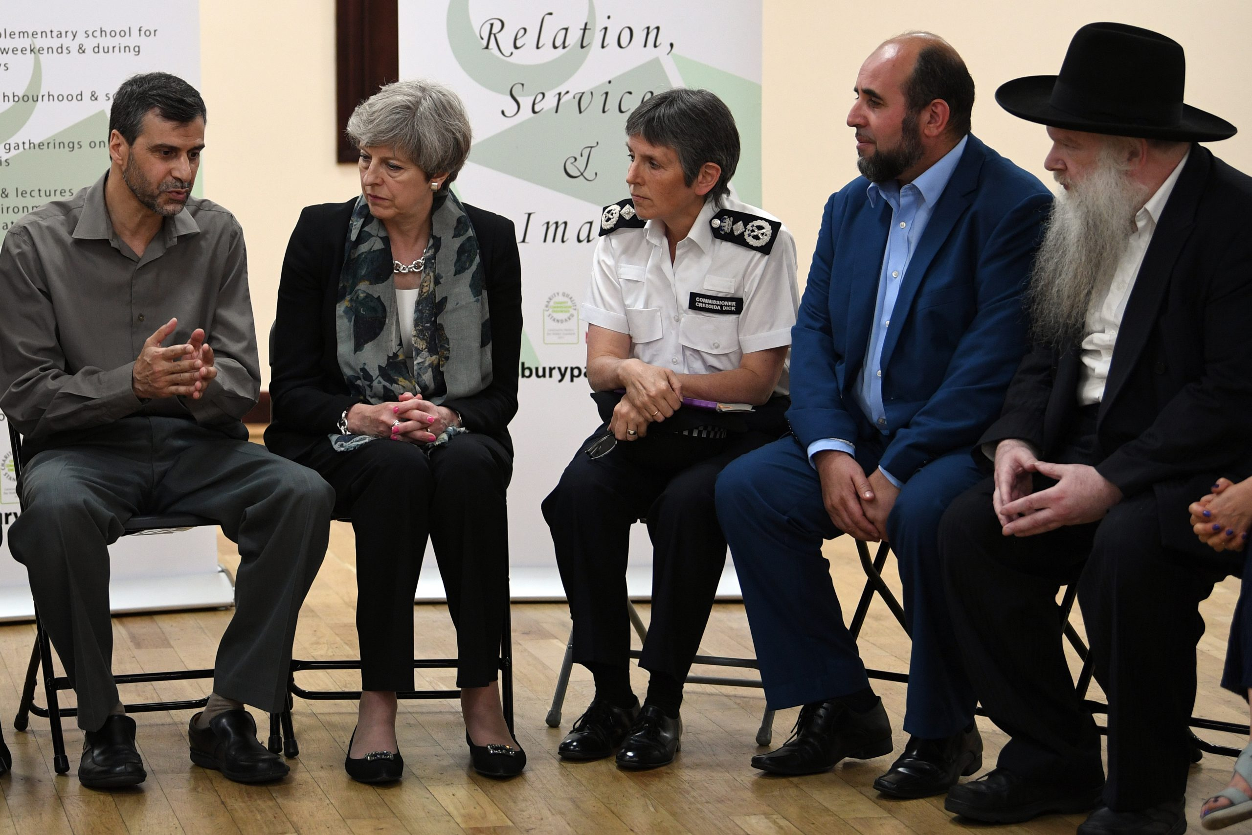 LONDON, ENGLAND - JUNE 19: Prime Minister Theresa May and Metropolitan Police Commissioner Cressida Dick talk to faith leaders at Finsbury Park Mosque.  Worshippers were struck by a hired van as they were leaving the mosque in North London after Ramadan prayers. (Stefan Rousseau/WPA Pool/Getty Images)