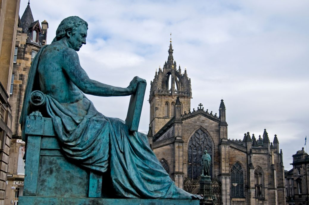 The statue of David Hume on the Royal Mile with St Giles Cathedral Beyond, Edinburgh Lothian Region Scotland  SCO 6076