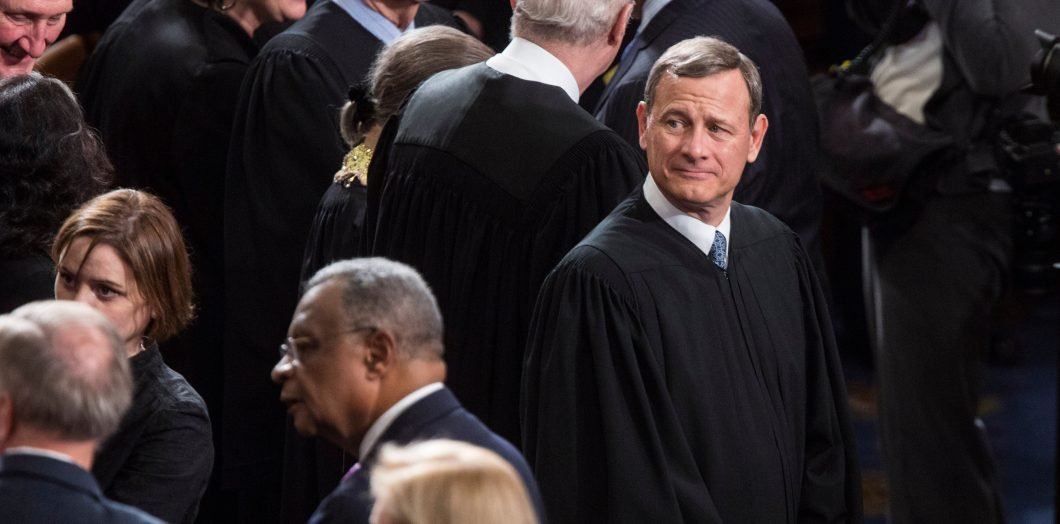 John Roberts, Chief Justice of the U.S. Supreme Court wait for the start of the State of the Union Address on Capitol Hill.