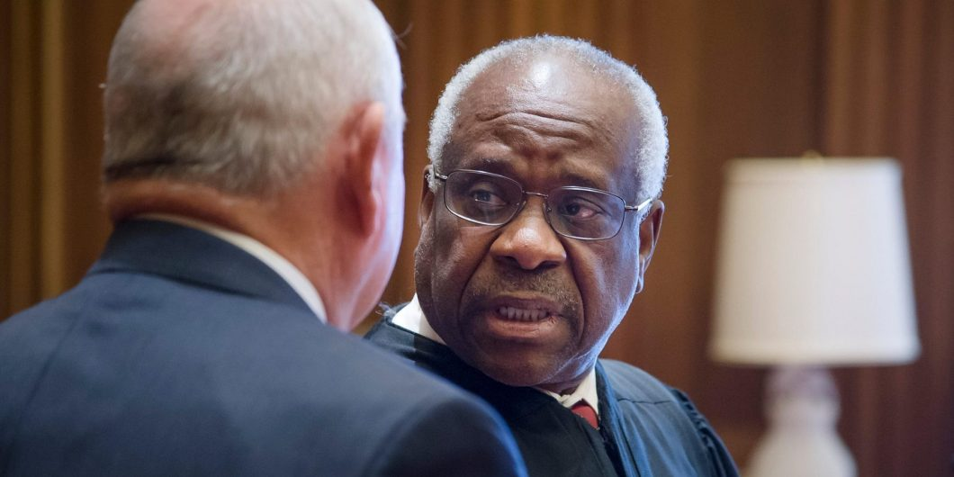 Former Georgia Gov. Sonny Perdue, left, chats with Supreme Court Clarence Thomas following his swearing in ceremony as the 31st U.S. Secretary of Agriculture at the Supreme Court April 25, 2017 in Washington, DC.