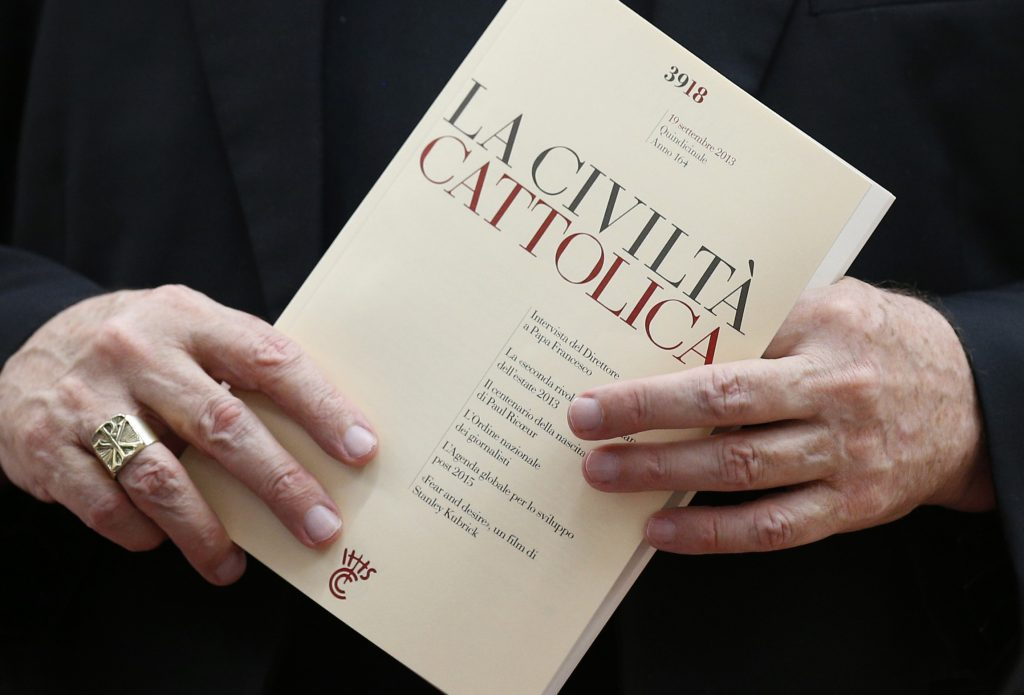 Archbishop Coleridge of Brisbane holds La Civilta Cattolica before meeting of Pontifical Council for Social Communications at Vatican