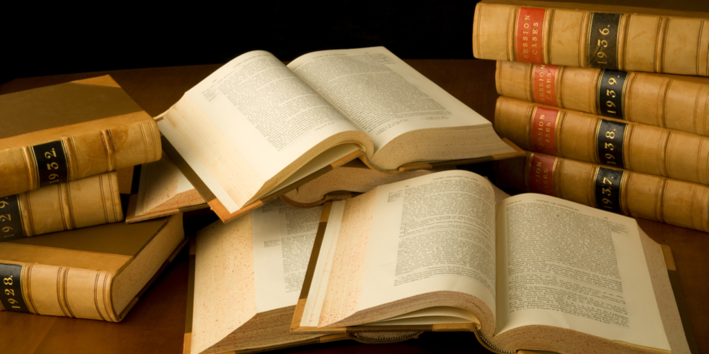 Law books open on table