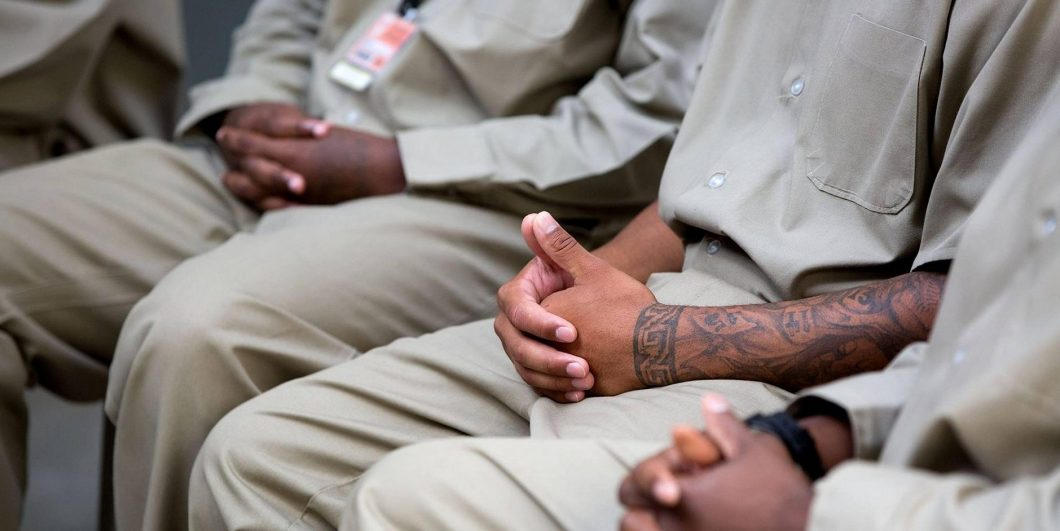 Prison inmates listen during discussions with U.S. President Barack Obama at El Reno Federal Correctional Institution July 16, 2015 in El Reno, Oklahoma. Obama's trip was the first visit by a sitting President to a federal prison.
