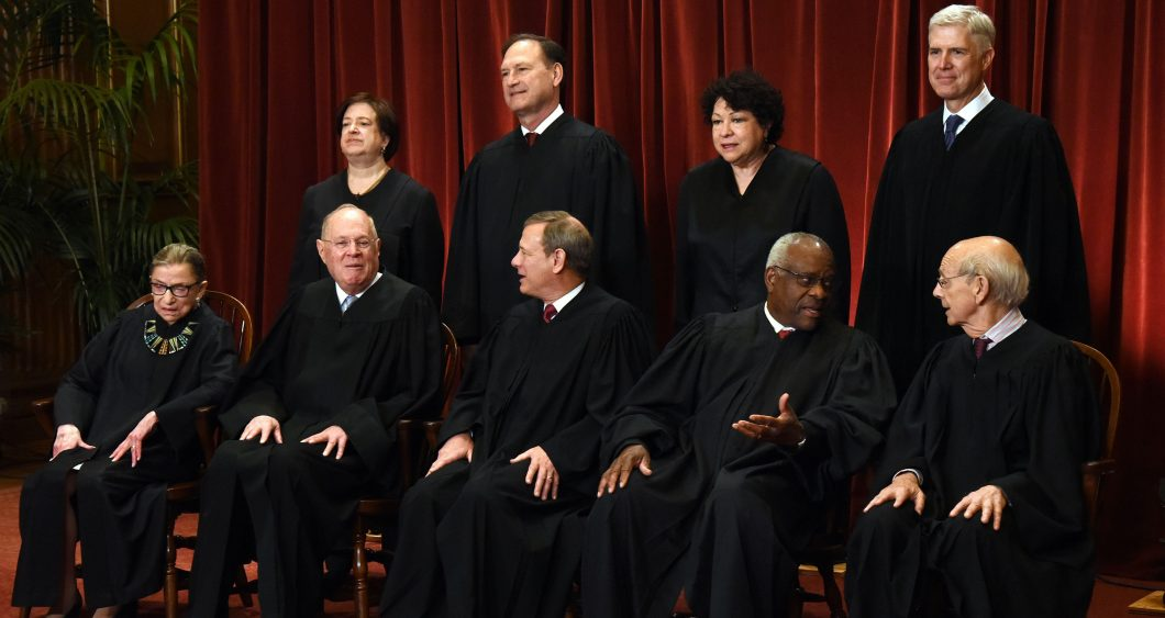 Members of the US Supreme Court pose for a group photograph at the Supreme Court building on June 1 2017 in Washington, DC. Front row. Seated from left, Associate Justice Ruth Bader Ginsburg, Associate Justice Anthony M. Kennedy, Chief Justice of the Unit