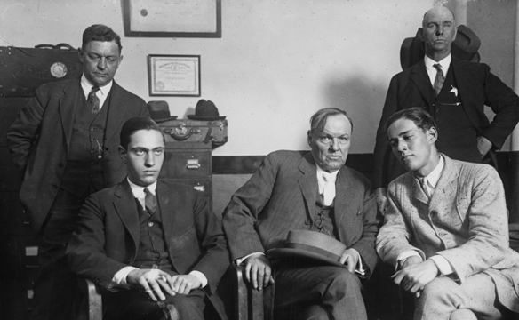 Clarence Darrow seated center meets with his clients Nathan Leopold seated left and Richard Loeb seated right in 1924.