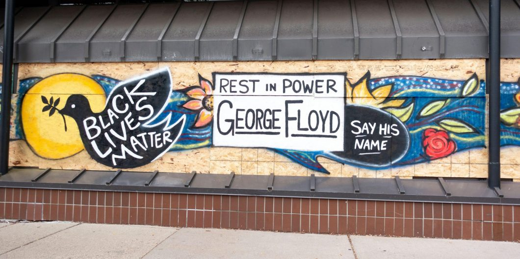 """George Floyd """"Rest in Power"""" """"Black Lives Matter"""" """"Say his Name"""" painted on plywood window. protectors. Minneapolis Minnesota MN USA"""