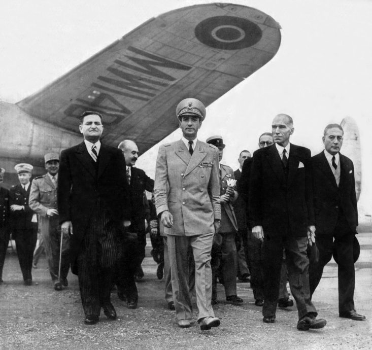 Shah of Iran Mohamed Reza Pahlavi arriving at Bourget airport (Paris) on august 1st, 1948 welcome by Andre Marie (head of government), Robert Schuman (french minister of foreign affairs), Rene Mayer (french minister of defence), Jules Moch (french minis